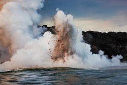 A small taste of the Fury of Mother Nature. Hot lava gushes out from lava tubes into the ocean and, when coinciding with incoming waves, creates spectacular mini explosions such as these.