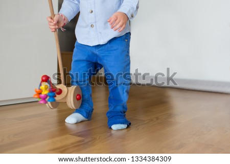 A small toddler boy, peeing in his pants, could not make it on time on the potty, child playing and forgetting to go pee. Kids potty traning #1334384309
