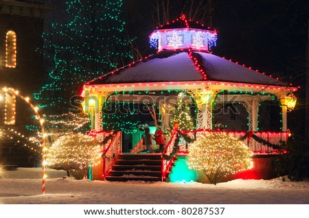 A small-town Christmas display centered around the village gazebo