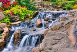A small waterfall at a miniature gold course in High Dynamic Range