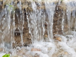 A small waterfall. Flowing water erodes the soil