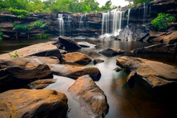 A small waterfall in the deep forest of the border of Thailand and Cambodia,Wang Yai  waterfall in tropical forest,Sisaket province,Thailand. Leaf moving low speed shutter blur.