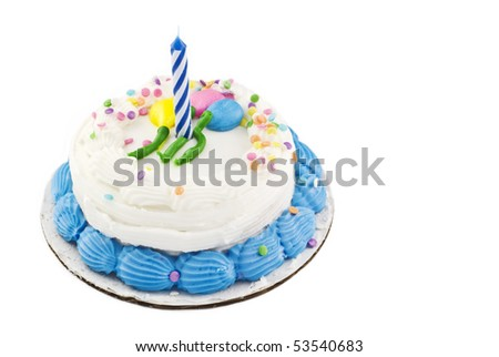 A small white birthday cake with balloon decoration and candy sprinkles, one unlit candle