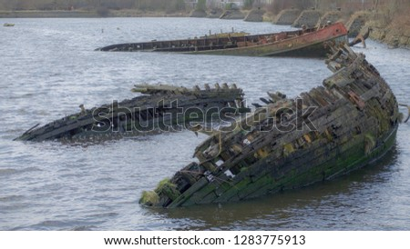 A small wooden boat and iron boat shipwrecked on the River Clyde close to Bowling harbour.