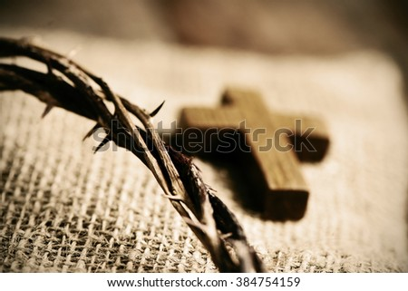 a small wooden cross and a...