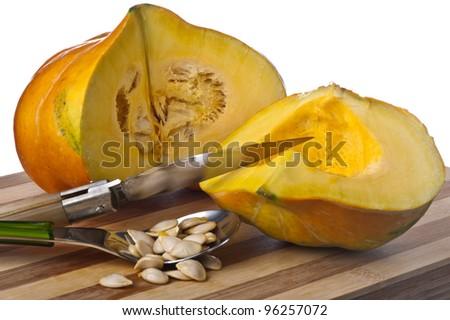 a small yellow squash on a bamboo cutting board