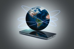a smart phone with 3d hologram globe communication concept.some