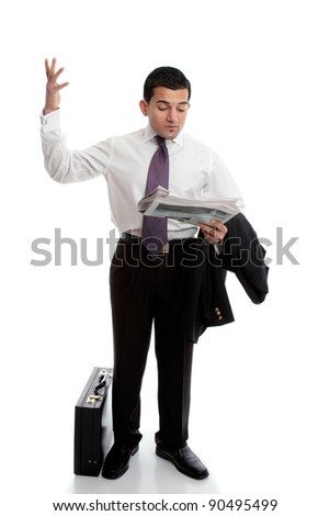 A smartly dressed businessman reading the newspaper and throwing up his hands in disbelief.  Parts have been intentionally blurred.  White background.