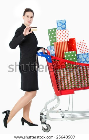 A smartly dressed woman shopping for gifts with a credit card on white