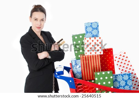 A smartly dressed woman shopping for gifts with a credit card on white.