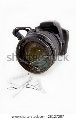 A smashed camera lens on a white background with all logos removed