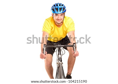 A smiling bicyclist with yellow shirt posing on a bicycle isolated on white background
