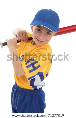 A smiling boy with a baseball or t-ball bat and uniform.  White background.