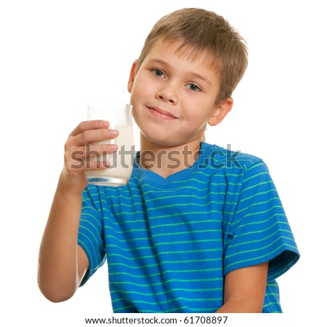 A smiling boy with a glass of milk in his hand; isolated on the white background