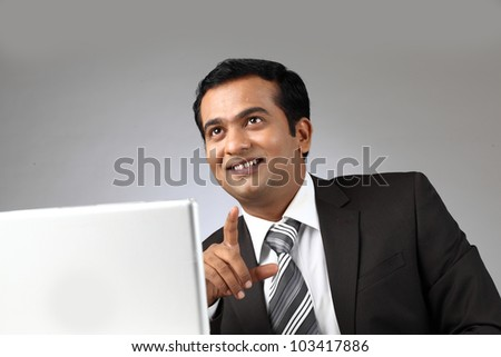 A smiling business man with laptop