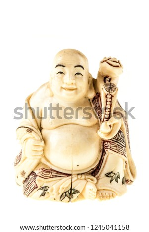 a smiling fat buddha statuette isolated over a white background