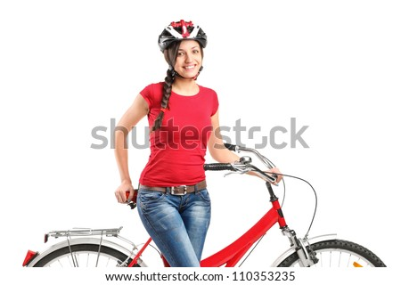 A smiling female posing next to a bicycle isolated on white background