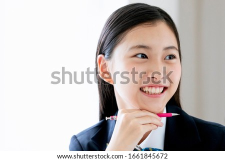 A smiling female student studying ストックフォト ©
