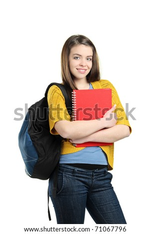 A smiling female student with a school bag holding a book isolated on white background
