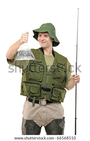 A smiling fisherman with fishing pole holding a plastic bag filled with water isolated on white background