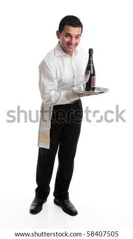 A smiling friendly waiter, bartender, or domestic staff, holding or presenting a tray with a bottle of  wine and glasses.  White background.