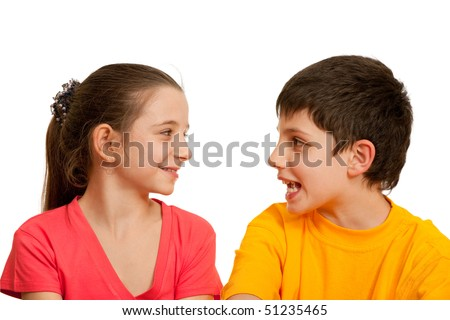 A smiling girl is listening to her friend; isolated on the white background
