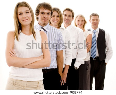 A smiling group of business people in a line (Shallow depth of field used)