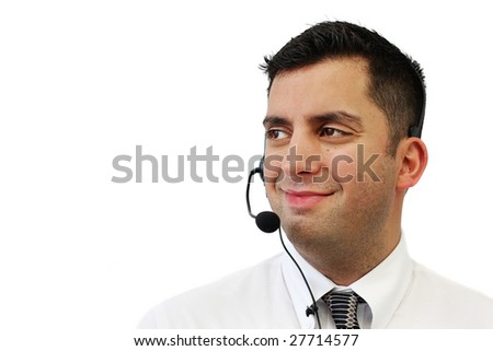 A smiling handsome man wearing a headset isolated over white