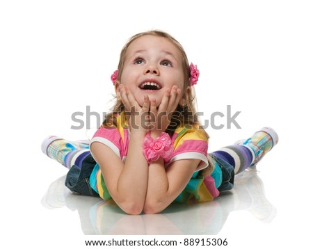 A smiling little girl is looking up; isolated on the white background