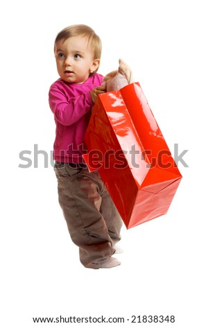 a smiling little girl isolated on white background with a shopping bag