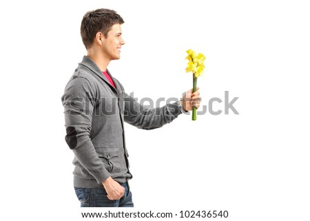 A smiling man holding a bunch of yellow flowers isolated on white background