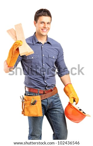 A smiling manual carpenter holding a helmet and sills isolated on white background - stock photo