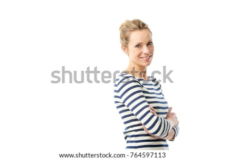 A smiling mature woman looking at you while standing at isolated white bakcground with copy space.