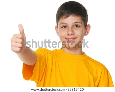 A smiling teenager shows his thumb up; isolated on the white background