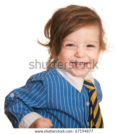 A smiling toddler with long hair wearing a business shirt and a tie; isolated on the white background - stock photo