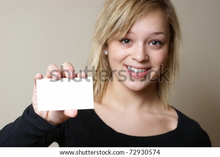 A smiling woman presents a blank card for your messages to be inserted with ease.