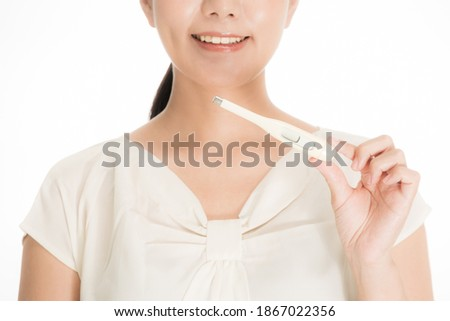 a smiling Woman with a thermometer Stock photo ©