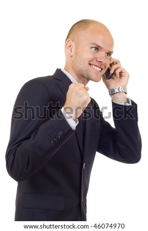 a smiling young business man discussing on a cell phone,winning something, isolated on white background