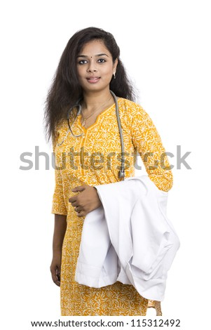 A smiling young Indian Female Doctor on white background.