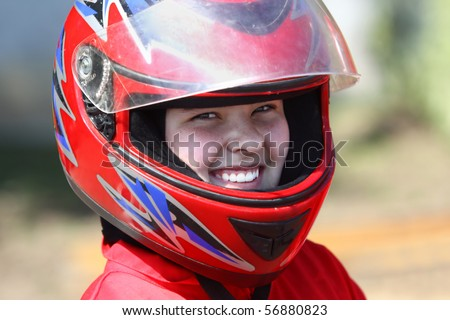 A smiling young  racer