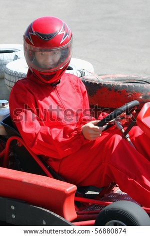 A smiling young  racer. Go-carting