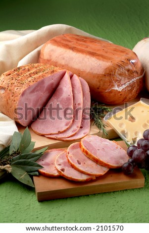 a smoked ham still life over a table - stock photo