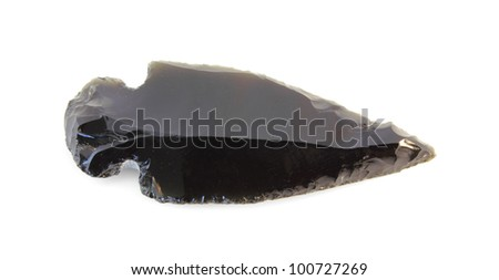 A smooth, chiseled, Native American Indian arrowhead isolated on white.