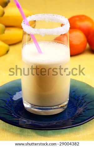 A smoothie made from oranges and bananas in an elegant glass