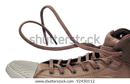 a sneaker boot with its shoelaces tied as a heart