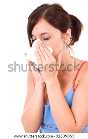 A sneezing woman isolated on white