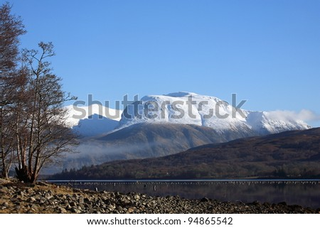 A snow capped Ben Nevis,highest mountain in the UK  from the shores of Loch Eil in Lochaber.