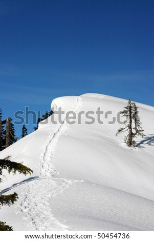 A snow mountain peak from winter hiking.