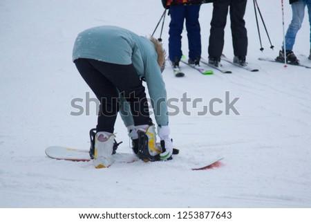 a snowboarder rides a snowboard #1253877643