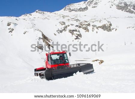 A snowcat grooming the ski slopes at Mölltaler gletscher  #1096169069